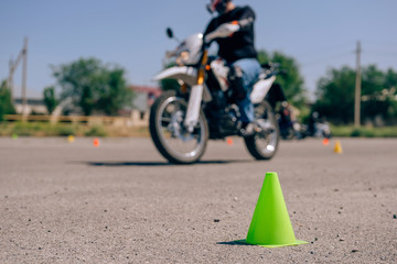 Green cone close-up on the site for bikers.  Traffic cones on the training ground in the driving...