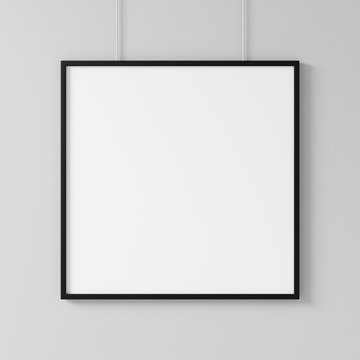 White square poster with black frame Mockup hanging on the wall