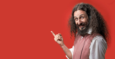 Eccentric telemarketer posing over a red background