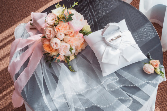 wedding rings in a box and a bouquet of the bride