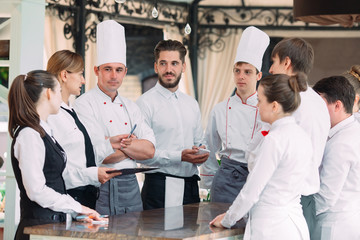 Foto op Canvas Restaurant Restaurant manager and his staff in terrace. interacting to head chef in restaurant.