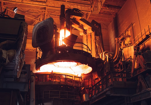 Melting of metal in a steel plant. High temperature in the melting furnace.