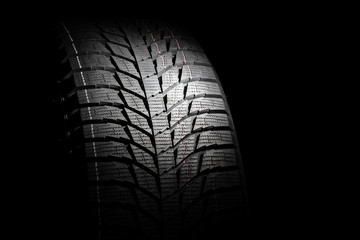 Winter high performance studless tire on black background