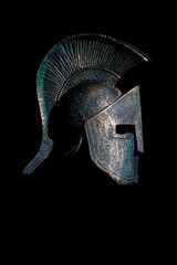 Ancient Spartan helmet on black background