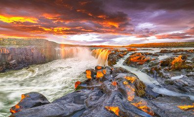 Dramatic sunset view of fantastic waterfall and cascades of Selfoss waterfall.