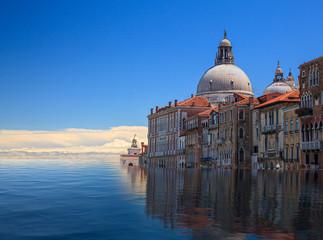 Concept image of a flooded Santa Maria Salute church in Venice as sea level rise makes the city uninhabitable