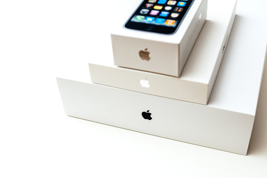 LONDON, UNITED KINGDOM - JAN 14, 2015: Three Apple Computers products packages boxes on top on a white background - unboxing smartphone iPhone, iPad and MacBook pro laptop