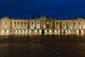 Poster de jardin Lieu d Europe Place du Capitole at night with dark blue dramatic sky in Toulouse, France