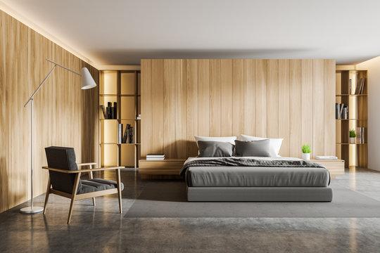 Wooden bedroom interior with armchair