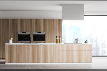 Close up of island in panoramic wooden kitchen