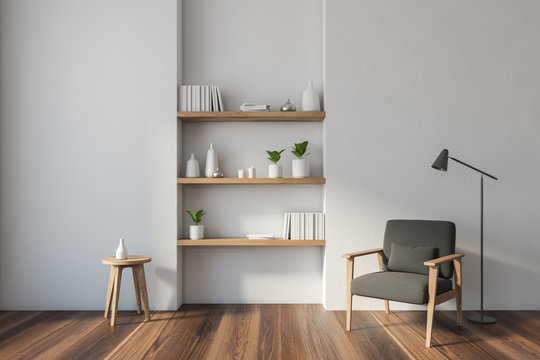 White living room with armchair and shelves