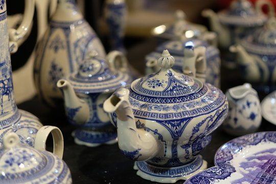 close up many traditional Chinese teapots. Blur background