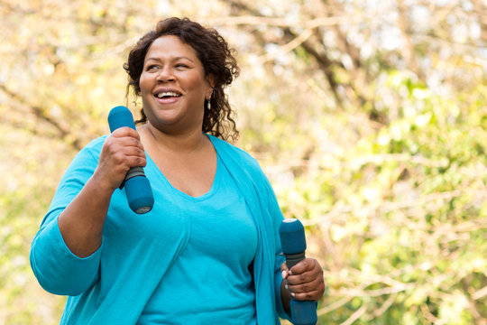 Beautiful mature African American woman smiling and laughing.