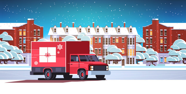 santa claus driving delivery van with gift box container shipping transport for merry christmas happy new year winter holidays celebration concept horizontal snowy cityscape background flat vector