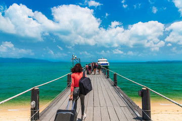 Horizon view group of traveler walking on wood pier cruise speed boat Koh Samui island, Travel Thailand beach, Tourist people on summer holiday vacation trips, Tourism beautiful destination place Asia