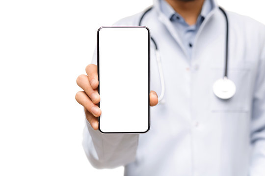 Male doctor demonstrating smartphone with blank screen for advertisement
