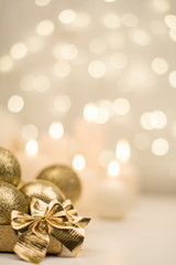Box with golden christmas ball on golden star bokeh background