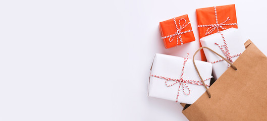 Eco Shopping bag with colorful gift boxes on white