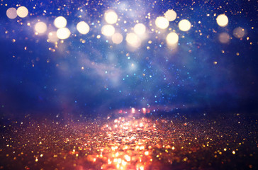 abstract glitter silver, gold , blue lights background. de-focused