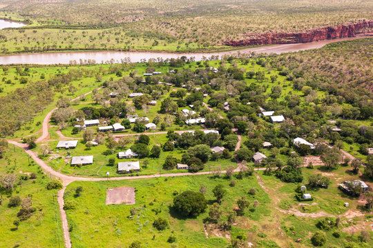 """Oblique aerial view of  the abandoned indigenous community """"Oombulguri,"""" formerly Forrest River Mission, near Wyndham in Cambridge Gulf in the Kimberley region of Western Australia."""