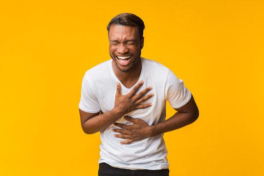 Black Man Standing Laughing Out Loud, Studio Shot