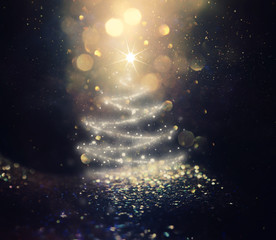 background of Christmas tree with defocused glitter lights