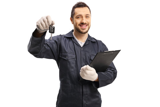 Auto mechanic with a car key and a clibboard