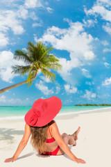 Brunette tanned girl in swimwear enjoying the beach