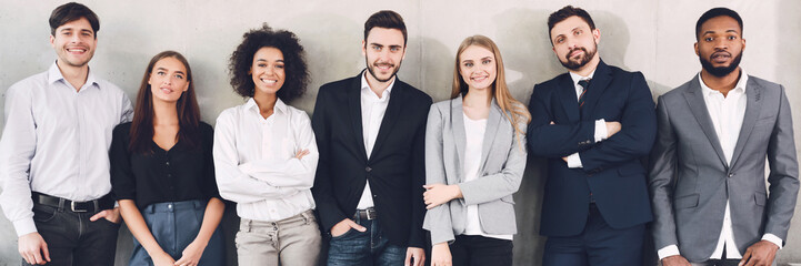 Diverse business team smiling to camera in office