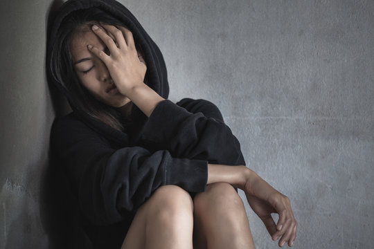 Alone and Scare asian woman,Human trafficking concept.Depression, Drug addiction symptoms.