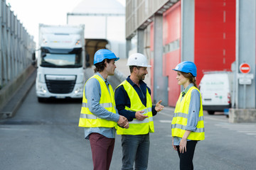 workers talking on the loading dock of a factory
