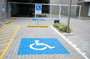 "Vacancy reserved for people with physical disabilities. Sign text translation: ""Parking Reserved for authorized vehicles"""