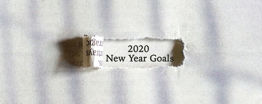 Paper hole with test, 2020 New Year Goals .