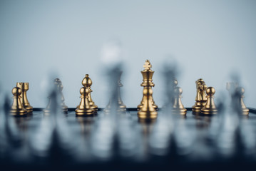Chess board game business strategy or leadership concept.