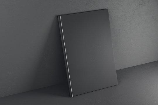 Empty black textbook on grey background