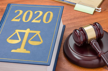 Law book with a gavel - 2020