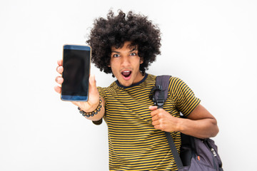 handsome young North African man with surprised expression showing mobile phone screen