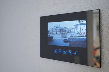 Intercom with video image mounted on the wall in the house. Close-up