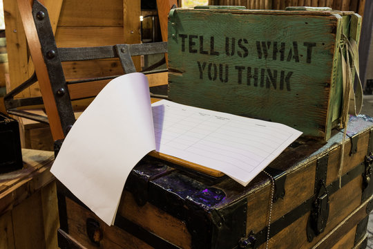 Guest book journal with old suggestion box. Tell us what you think.