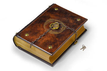 Brown leather book with metal pins in the corners, the gilded symbol and padlock with chain to lock the book