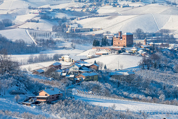 Rural houses on the hills covered in snow.