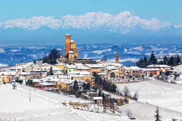 Small medieval town on snowy hill in Northern Italy.