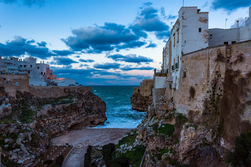 Winter twilight at Lama Monachile beach, Polignano a Mare, Bari Province, Puglia region in southern Italy.