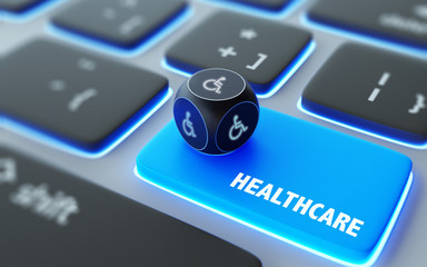 Wheelchair Symbol On A Dice Over Laptop Computer Keyboard with Healthcare Text on Enter Button