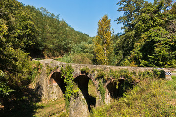 Stone bridge in beautiful landscape, near Vinci, Tuscany, Italy