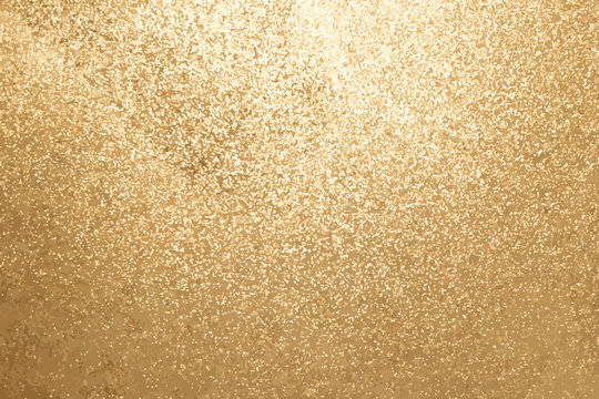 Gold color of glitter textured background (Vector)