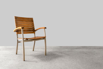 Brown Wood Armchair With Iron Legs on a gray floor and morning light