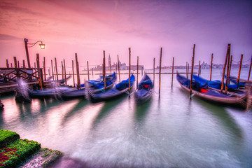 Foto op Plexiglas Gondolas Gondolas moored by Saint Mark square, Venice, Italy, Europe.