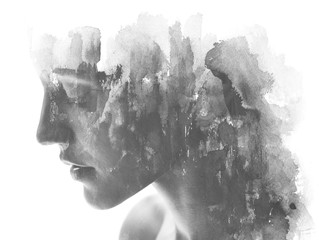 Paintography. Double exposure. Close up of an attractive model combined with hand drawn ink and watercolor painting with overlapping brushstroke texture, black and white
