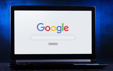 Laptop computer displaying logo of Google